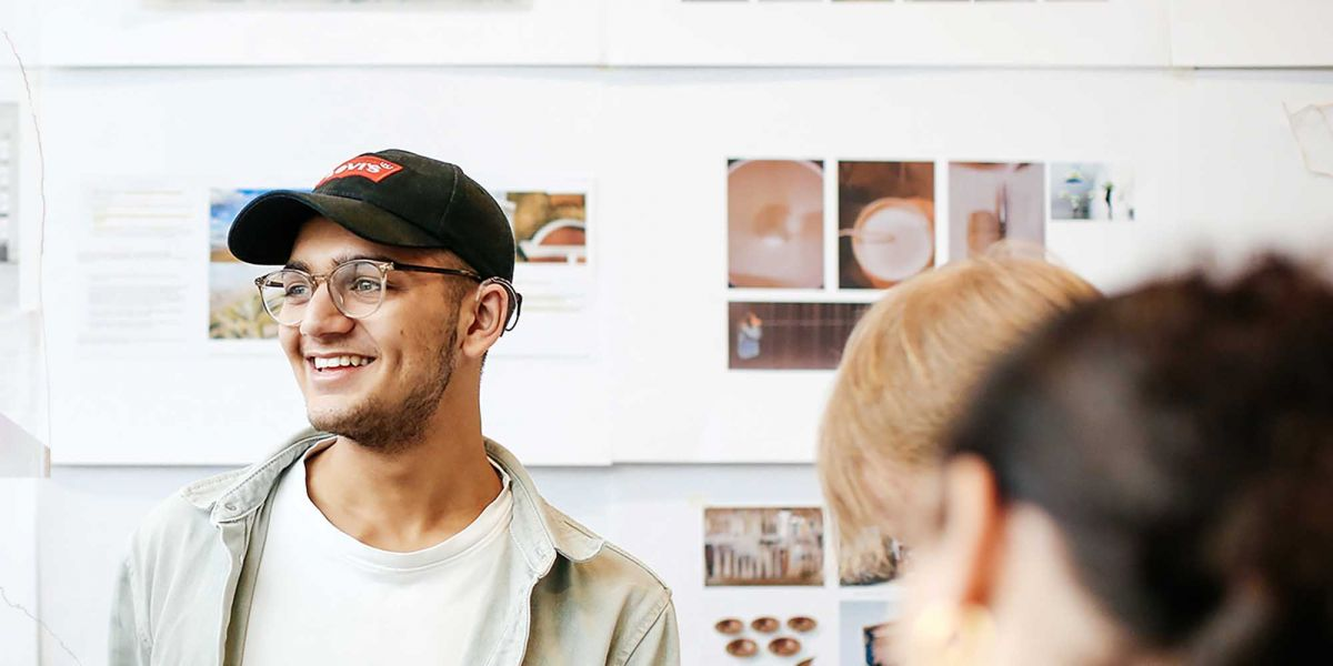 Student on a large deck chair