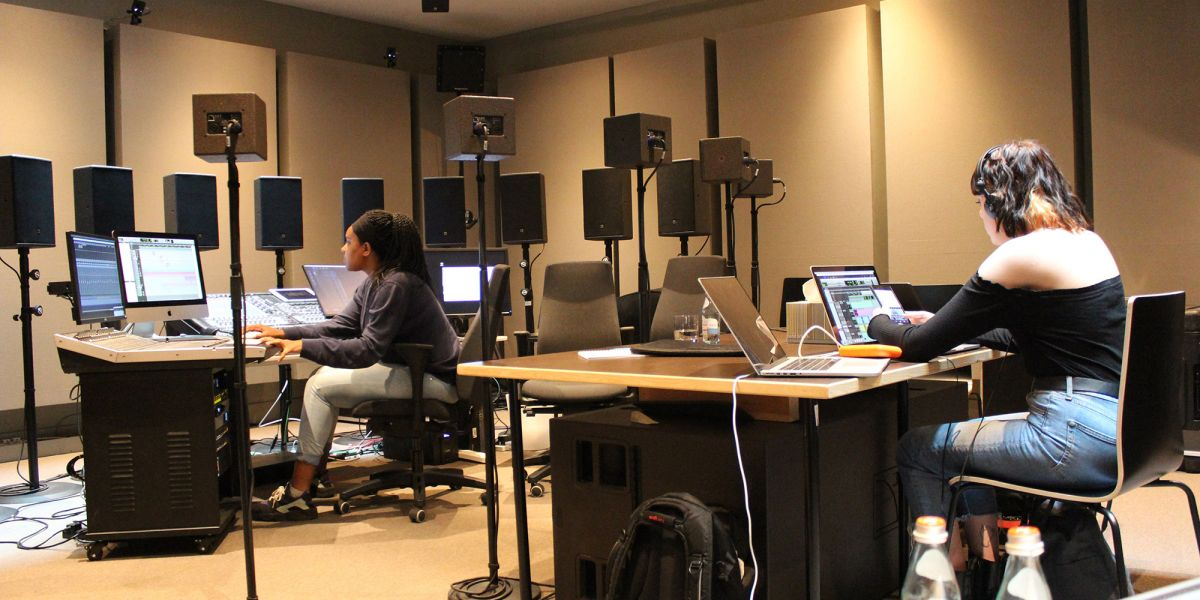 Students at separate desks in the studio.